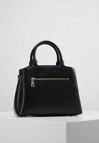 DKNY - MEDIUM SATCHEL - Handbag - black/gold - 2