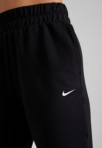 Nike Performance - FLOW PANT - Tracksuit bottoms - black/white - 5