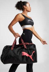Puma - ESS BARREL BAG - Sports bag - black/pink alert - 1