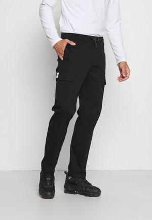 FRAIL LOORIX PANT - Reisitaskuhousut - black