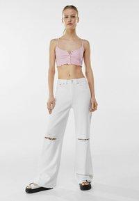 Bershka - Flared jeans - white - 1