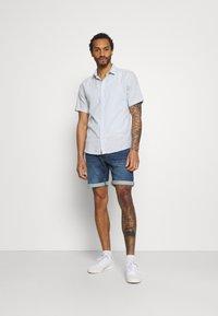 Redefined Rebel - SYDNEY TERRY - Denim shorts - hard blue - 1