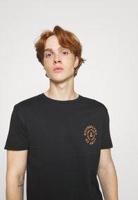 Quiksilver - CAUTIONARY TALE - Print T-shirt - black - 3