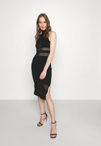 Hervé Léger - HERVE LEGER X JULIA RESTOIN ROITFELD HALTER COLUMN DRESS - Cocktail dress / Party dress - black - 4