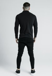 SIKSILK - DANI ALVES FITTED - Polo - black/gold - 2