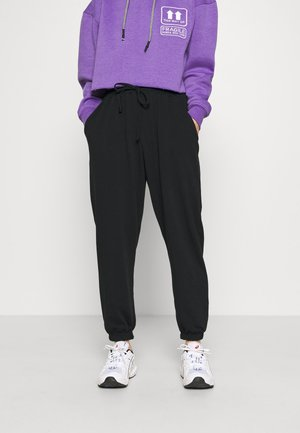 90S JOGGERS - Tracksuit bottoms - black