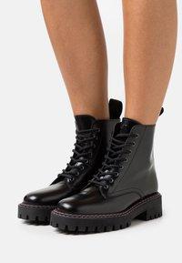 LÄST - PAINT BOOT - Lace-up ankle boots - black - 0