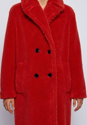 CATEDOLANA - Winter coat - dark orange