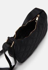 Lindex - BAG BAGUETTE QUILTED - Handbag - black - 2