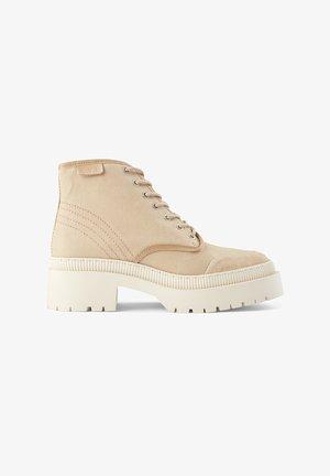 Platform ankle boots - sandfarben