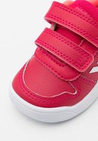 adidas Performance - TENSAUR UNISEX - Walking trainers - power pink/footwear white/signal pink - 5