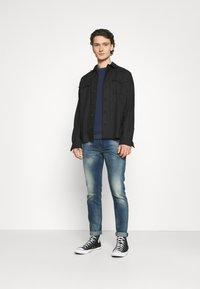 Diesel - THOMMER-X - Slim fit jeans - medium blue - 1