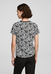 KARL LAGERFELD - Print T-shirt - black/white
