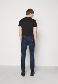Emporio Armani - POCKETS PANT - Slim fit jeans - dark-blue denim - 2