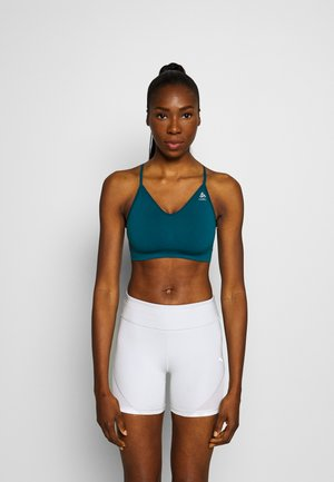 SEAMLESS SOFT SPORTS BRA - Light support sports bra - submerged