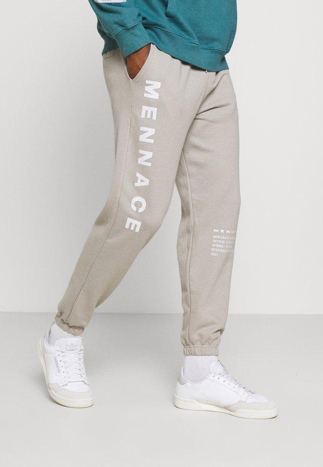 ON THE RUN - Teplákové kalhoty - grey