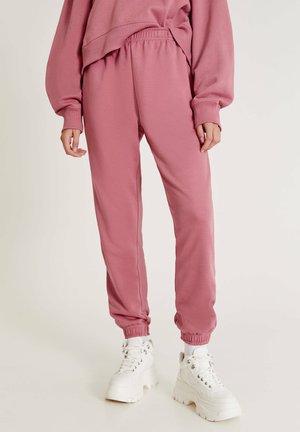 BASIC-JOGGER - Tracksuit bottoms - pink