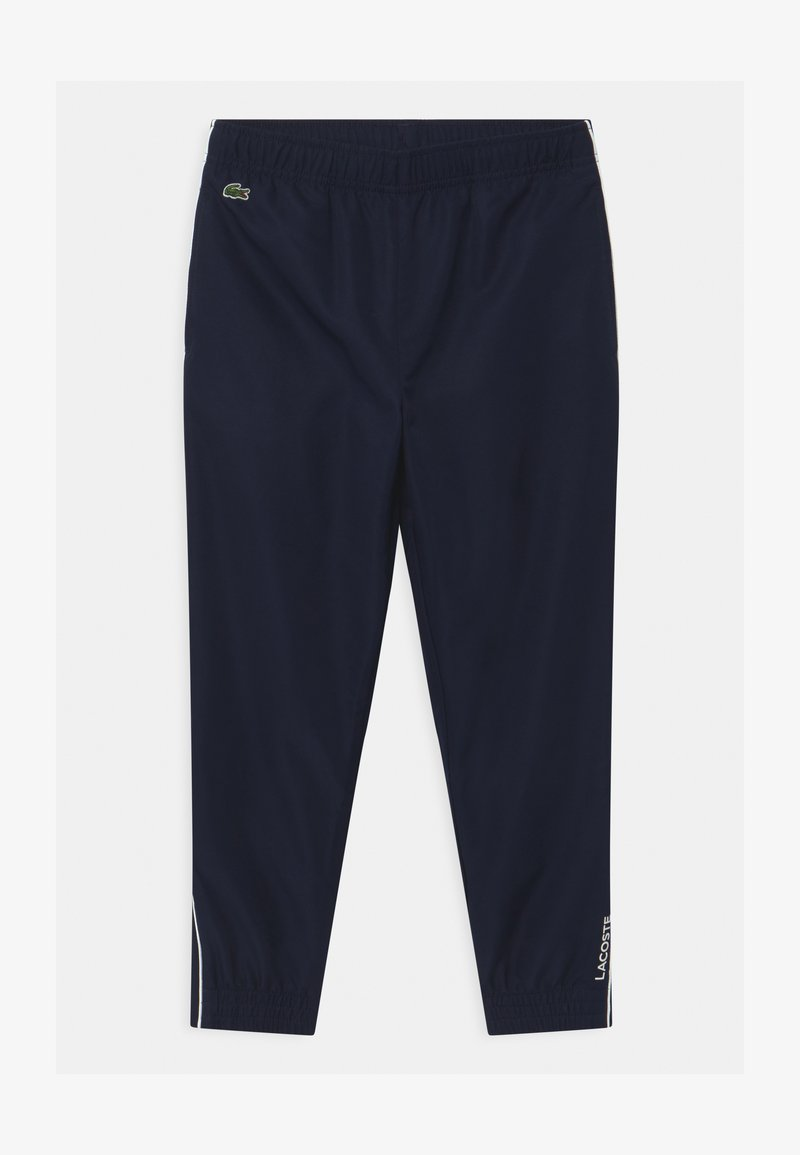 Lacoste Sport - TENNIS UNISEX - Tracksuit bottoms - navy blue/white