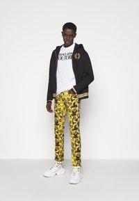 Versace Jeans Couture - TUPO - Slim fit jeans - black - 1