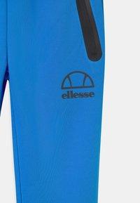 Ellesse - DESTRO UNISEX - Tracksuit bottoms - neon blue - 2