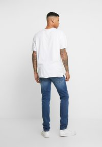 Replay - ANBASS HYPERFLEX BIO - Slim fit jeans - medium blue