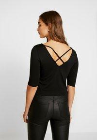 Vero Moda - VMPANDA CROSS  - T-shirt imprimé - black - 2