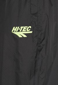 Hi-Tec - HUEY LIGHTWEIGHT TRACK PANTS - Tracksuit bottoms - black