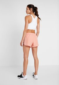 Nike Performance - RUN SHORT - Pantalón corto de deporte - pink quartz/white - 2