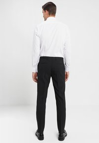 Tommy Hilfiger Tailored - Suit trousers - black - 2