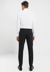 Tommy Hilfiger Tailored - Spodnie garniturowe - black - 2