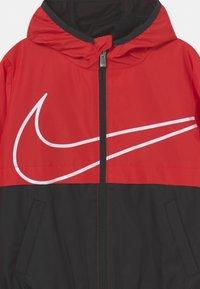 Nike Sportswear - WINDBREAKER UNISEX - Light jacket - university red - 2