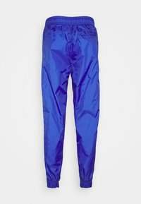 Nike Sportswear - Tracksuit - astronomy blue/university red/white - 5