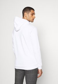 adidas Originals - ESSENTIAL HOODY UNISEX - Hoodie - white/scarle - 2