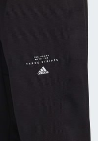 adidas Performance - MUST HAVES AEROREADY TRACKSUIT BOTTOMS - Tracksuit bottoms - black - 7