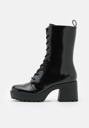 VEGAN ZORA BOOT - Enkellaarsjes met plateauzool - black