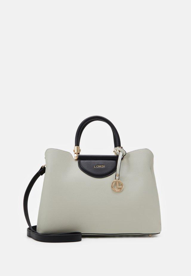 FABIOLA - Handbag - stone