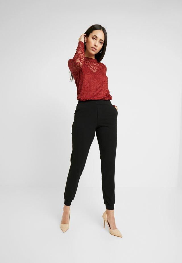 ONLADELE ROCKY PANTS - Trousers - black