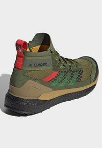 adidas Performance - FREE HIKER BOOST PRIMEKNIT HIKING SHOES - Hikingskor - green - 2