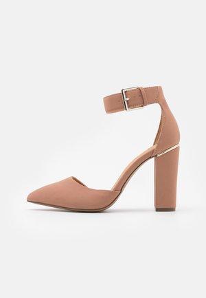 CAUTA - Classic heels - beige