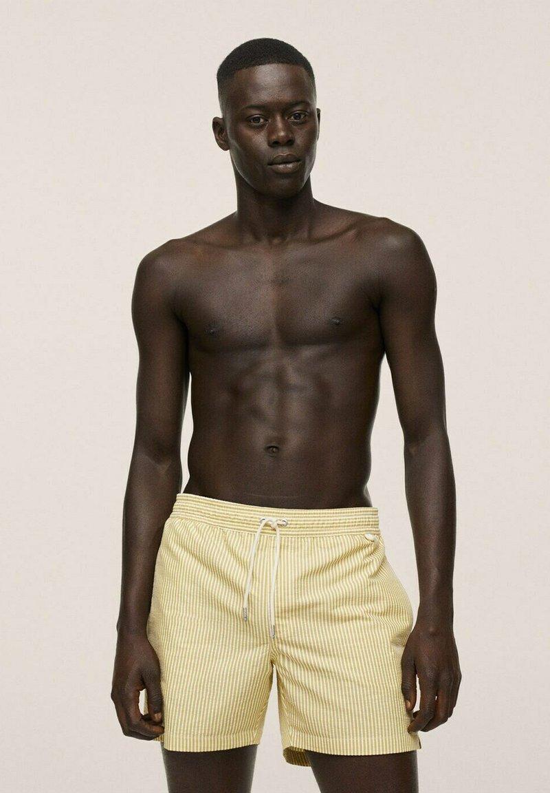 Mango - Swimming shorts - gelb
