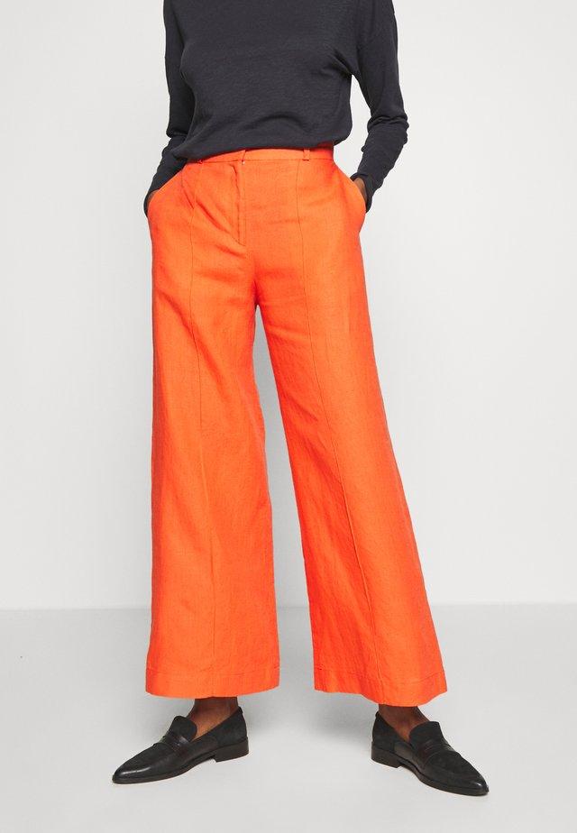 PANTS - Kalhoty - cinnabar