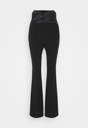 PANTALONE BOOTCUT - Trousers - nero