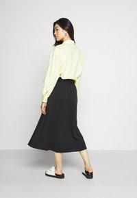 Monki - SIGRID BUTTON SKIRT - A-line skirt - black dark solid - 2