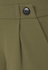 JDY - JDYGEGGO NEW LONG PANT - Trousers - kalamata/black - 2