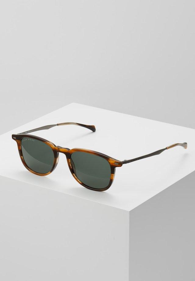 Sluneční brýle - horn
