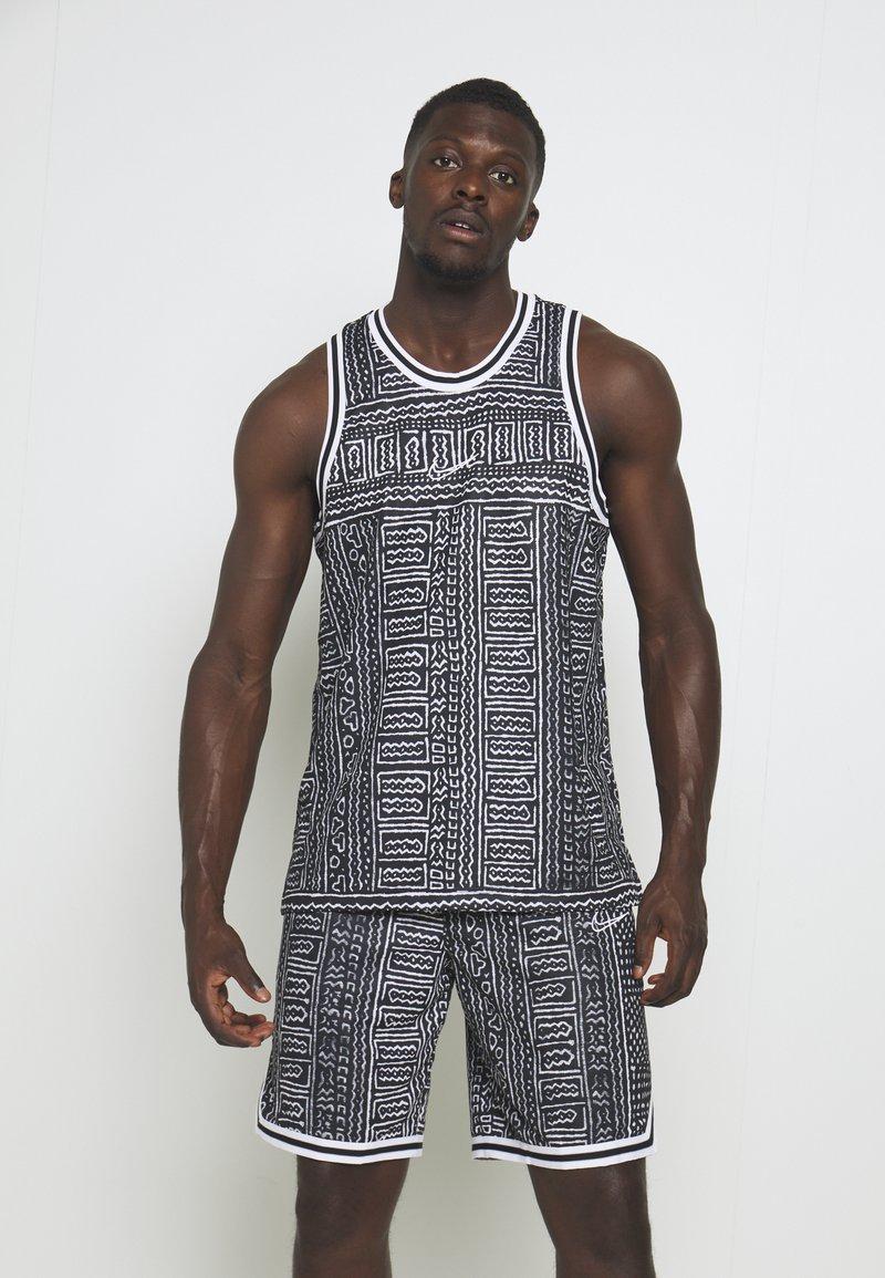 Nike Performance - DRY CITY EXPLORATION SEASONAL - Sports shirt - black/white
