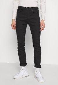 Calvin Klein Jeans - CKJ 016 SKINNY - Skinny džíny - black - 0