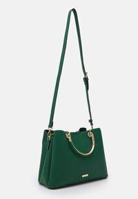 ALDO - CHERRAWIA - Handbag - green - 1