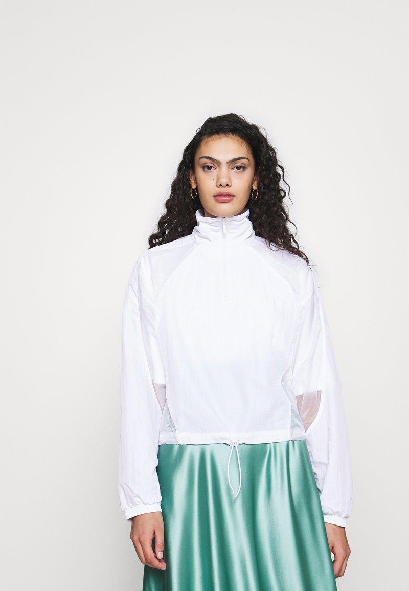 adidas Originals - LAYER - Chaqueta fina - white
