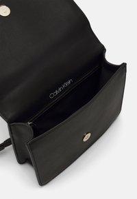 Calvin Klein - FLAP SHOULDER BAG - Across body bag - black - 2